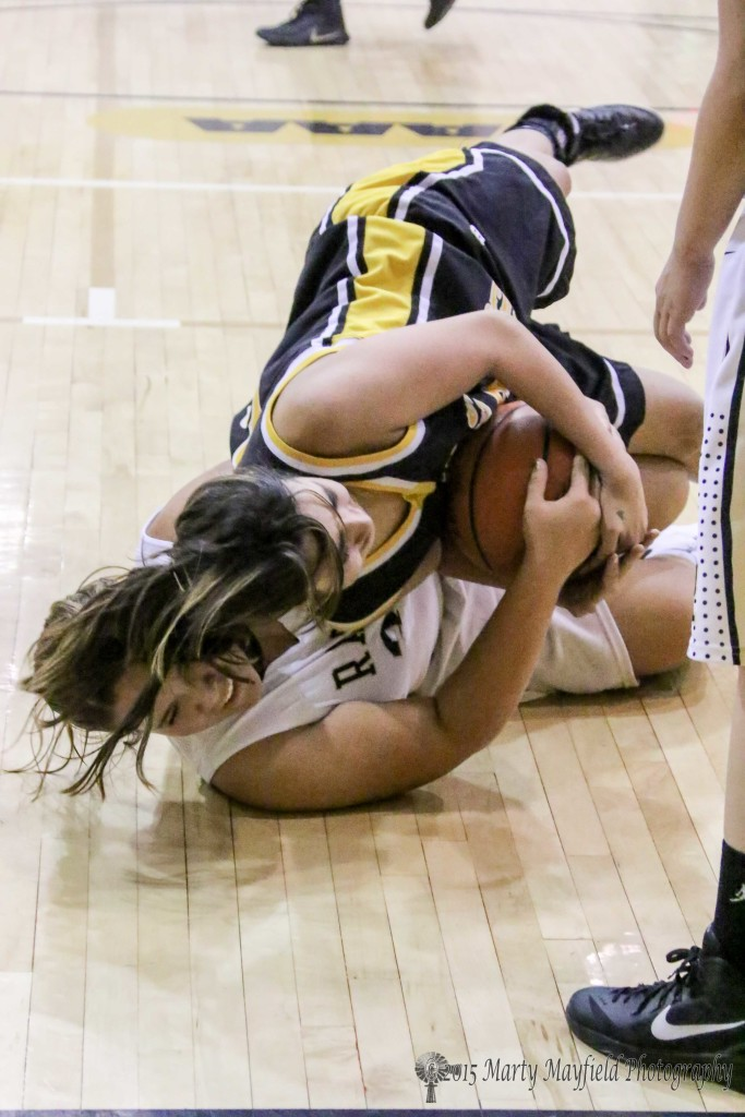 Sydni Silva on the bottom and Alexis Wingo tangle for the ball in this low scoring game.