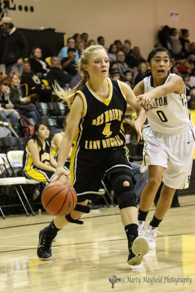 Autumn Archuleta calls for help as MaKenna Hittson drives to the lane in the second half of a a low scoring close game.