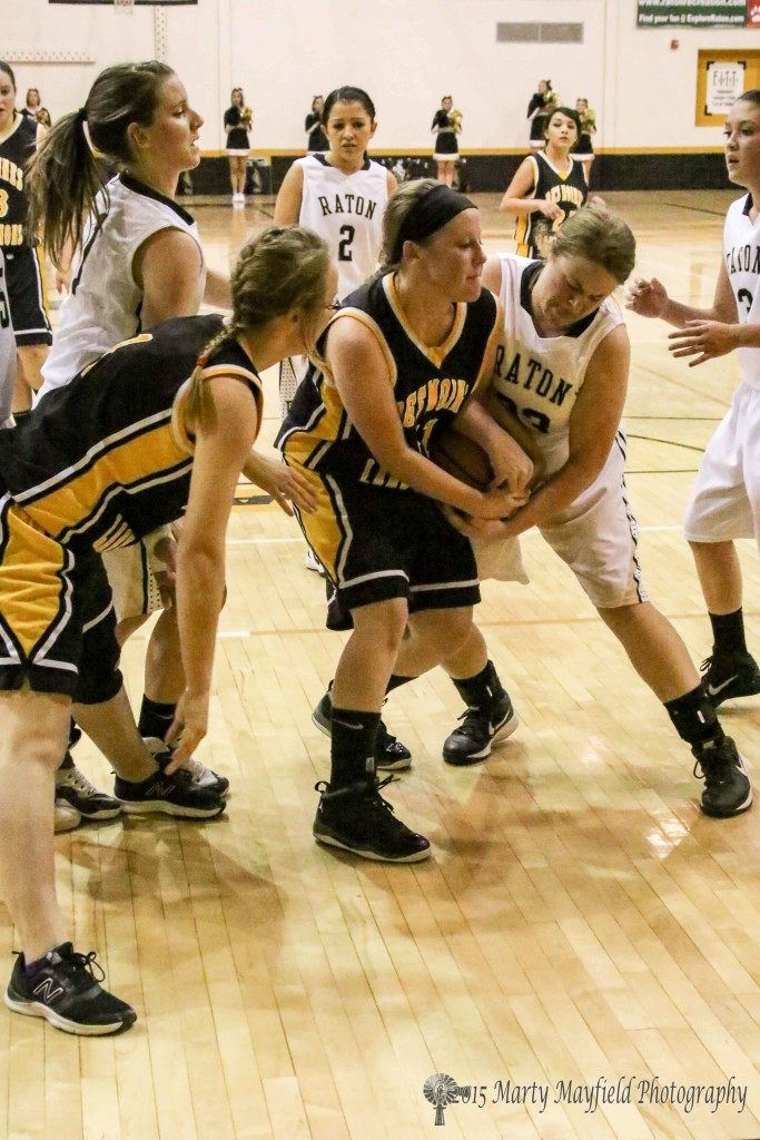 Jadyn Walton and Rayelle Rivale struggle for the ball