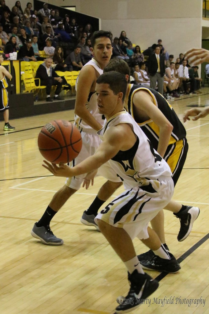 Cole Medina tries to save the ball as it heads out of bounds Saturday night during the game with Des Moines