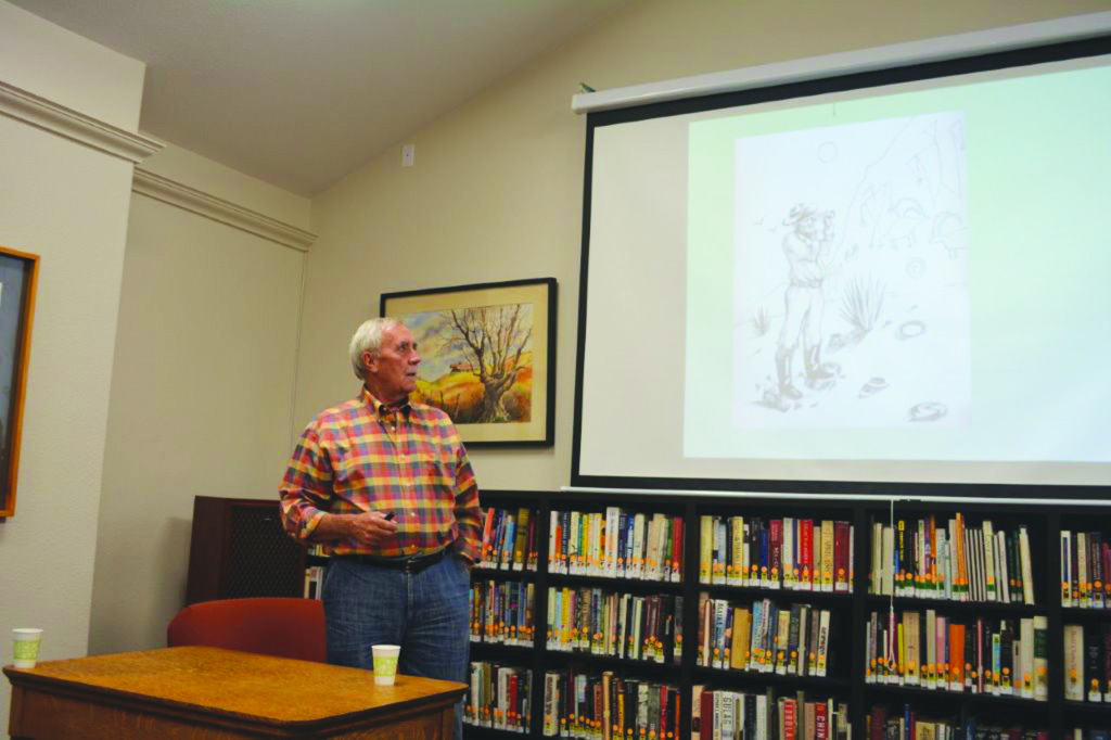 Dr. Lawrence Loendorf spoke at the La Veta Public Library on November 4, in an event that was co-sponsored by Francisco Crossing.  His book, Thunder and Herds, Rock Art of the High Plains, focuses on southeastern Colorado rock art. Here Loendorf explains what precautions are needed, when approaching a rock art panel.  Photo by Bob Kennemer.