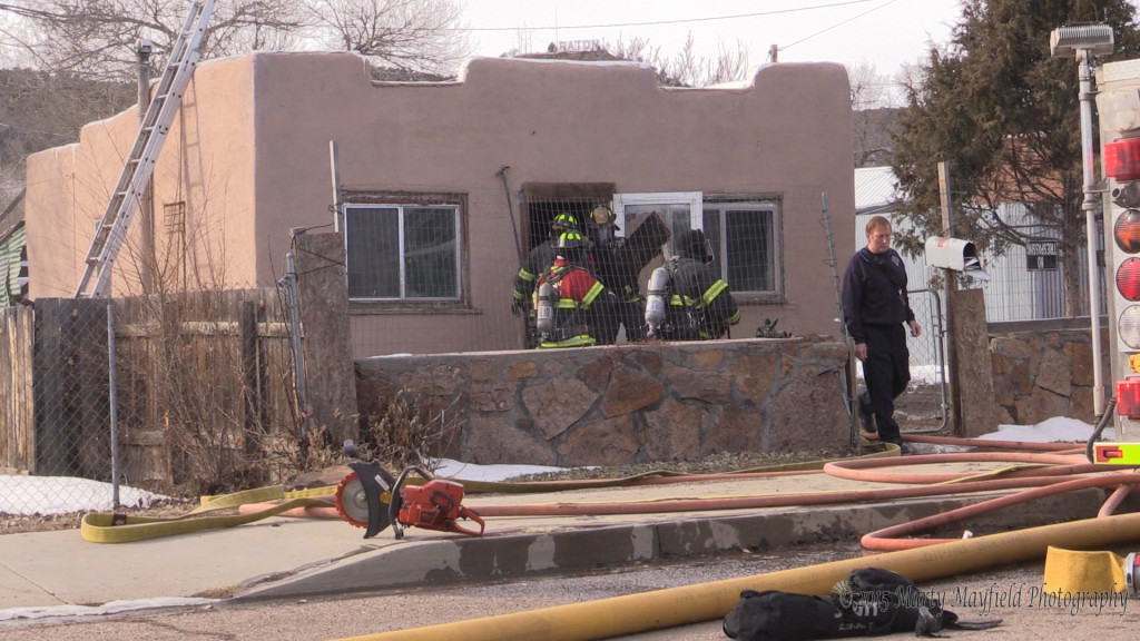 Raton fire fighters responded to 532 Martinez for a report of smoke coming from the roof of the house Tuesday afternoon just after 1pm. Fire fighters are removing wood from the inside of the house.