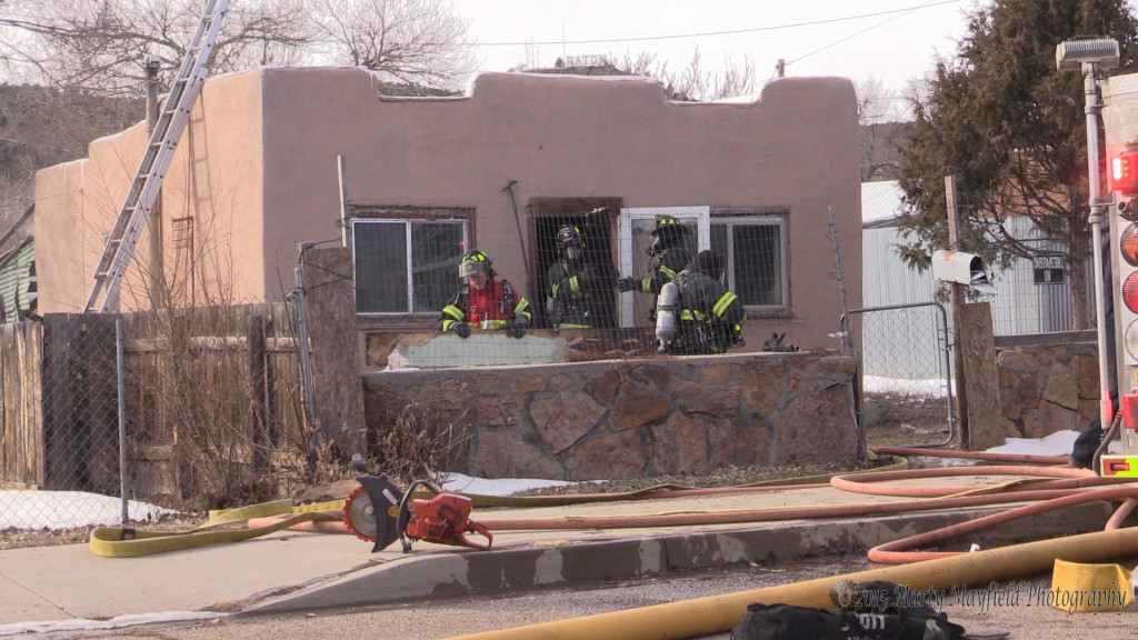 Fire Fighters remove wood from the inside of the house at 532 Martinez. Raton Fire and Emergency Services were called to that house for a report of smoke just after 1p.m. Tuesday afternoon