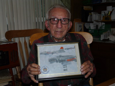 Albert (Al) Manfredi of Raton with illustration of the B-17 Flying Fortress