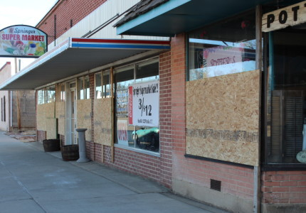 BROKEN WINDOWS ON MAIN ST.  Business after business in Springer, NM had their windows broken out last Saturday.  Photo by Sherry Goodyear