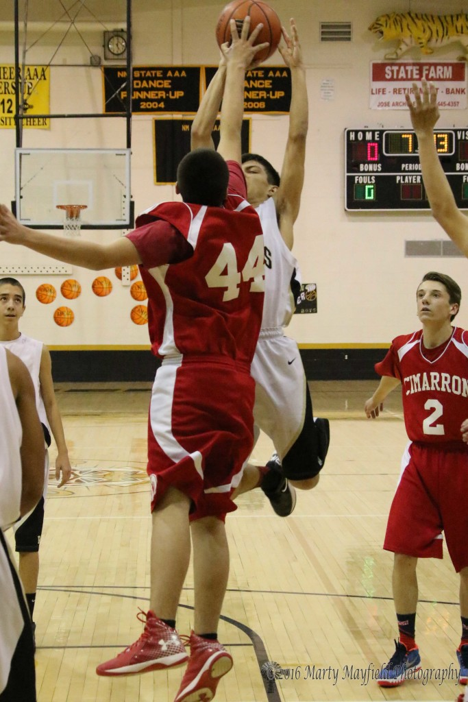 Ethan Martinez goes for the jumper as Austin Vargas goes for the block during the JV game Friday afternoon
