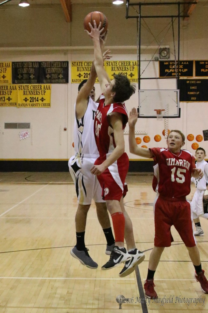 Zeke Sena takes the shot as Will Rittenhouse gets the block during the JV game in Tiger Gym Friday afternoon