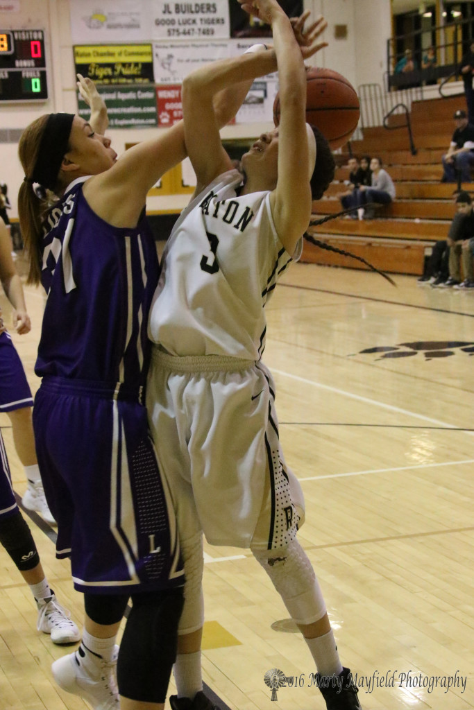 Cassidy Guana (31) makes the block and draws the foul as Estrella Vargas goes in for the shot Thursday evening in the girl's varsity game