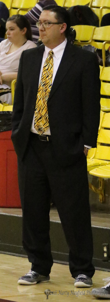 It was coaches against cancer night at Tiger Gym as boys coach Jose Archuleta wears the suit and sneakers