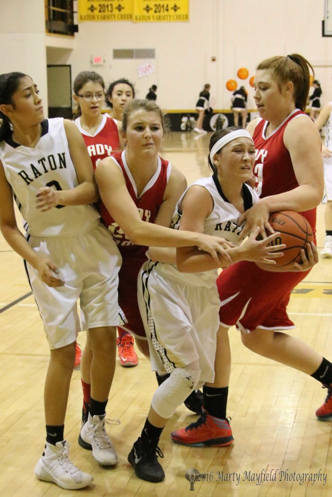 Estrella Vargas squeezes through the traffic of Gentry Hauckebo (left) and Mariah Vanderlei (right) as Autumn Archuleta (0) looks on