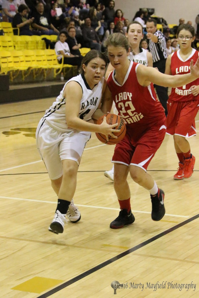 Andie Ortega works past Gentry Haukebo (22) on her way into the basket for two of her 12 points on the night