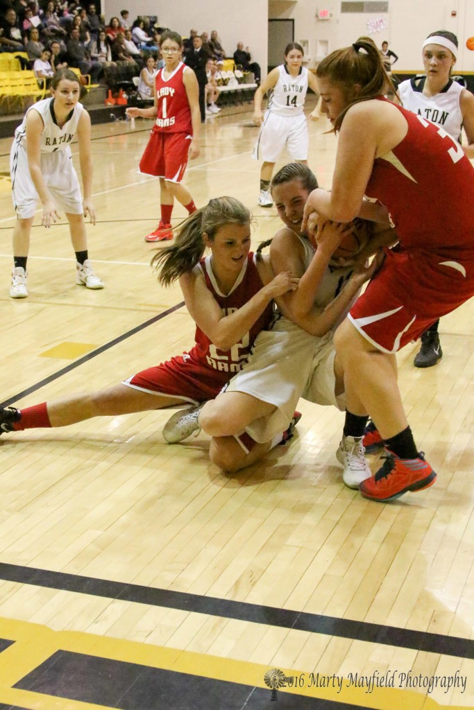 Halle Medina struggles with Mariah Vanderlei and Gentry Haukabo for possession of the ball