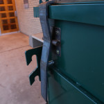 This new bear proof dumpster sports a spring loaded latch that will be tripped by the tongs on the garbage truck