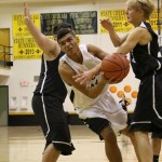 Darien Lewis drives down the lane through traffic during the JV game in Tiger Gym