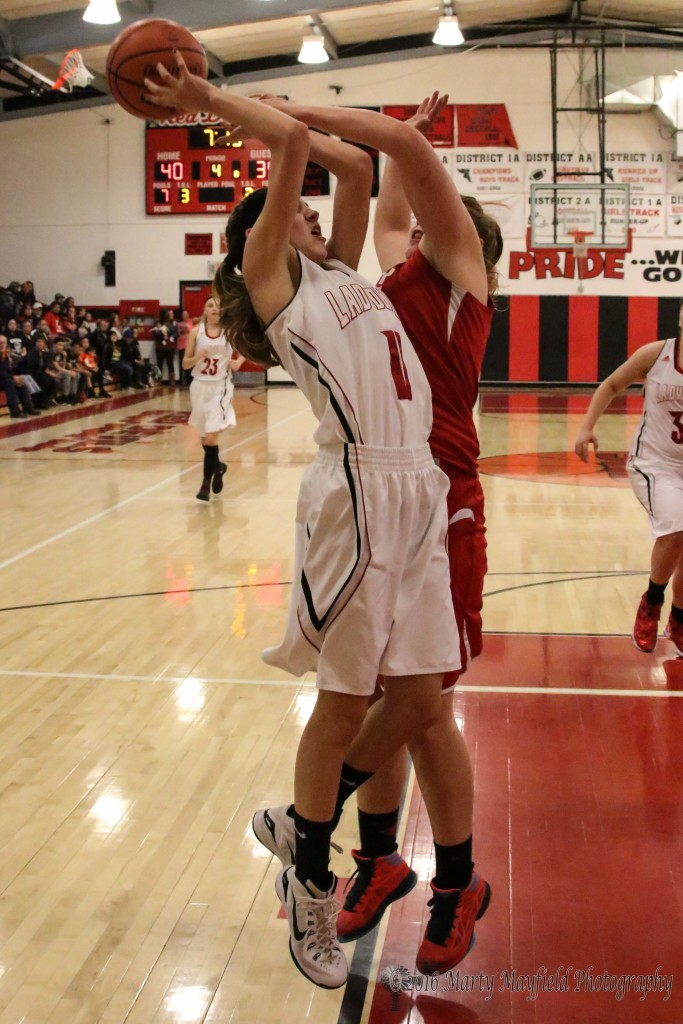 Hannah Burton goes for the shot as Mariah Vanderlei goes for the block and draws the foul sending Burton to the free throw line.