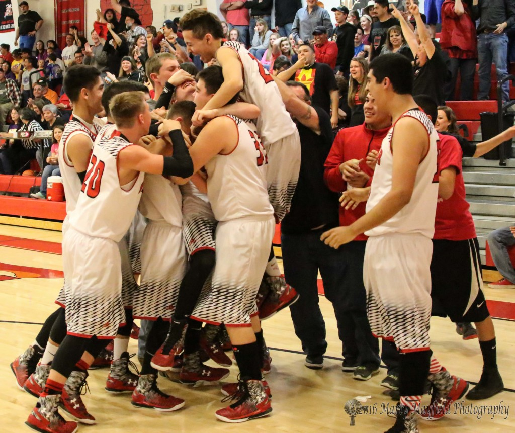 The celebration continues after Jacob Quintana made the winning shot to give Springer the championship win.