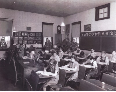 Classroom in the Sugarite School: Principal Loren Malcolm is shown in the back of the classroom, next to the chalkboard. (Courtesy of Joe Bertola Family)