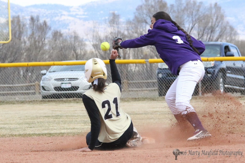 Safe at Second as Natausha Archuleta slides into second as Jadyn Romero loses the ball in the excitement.