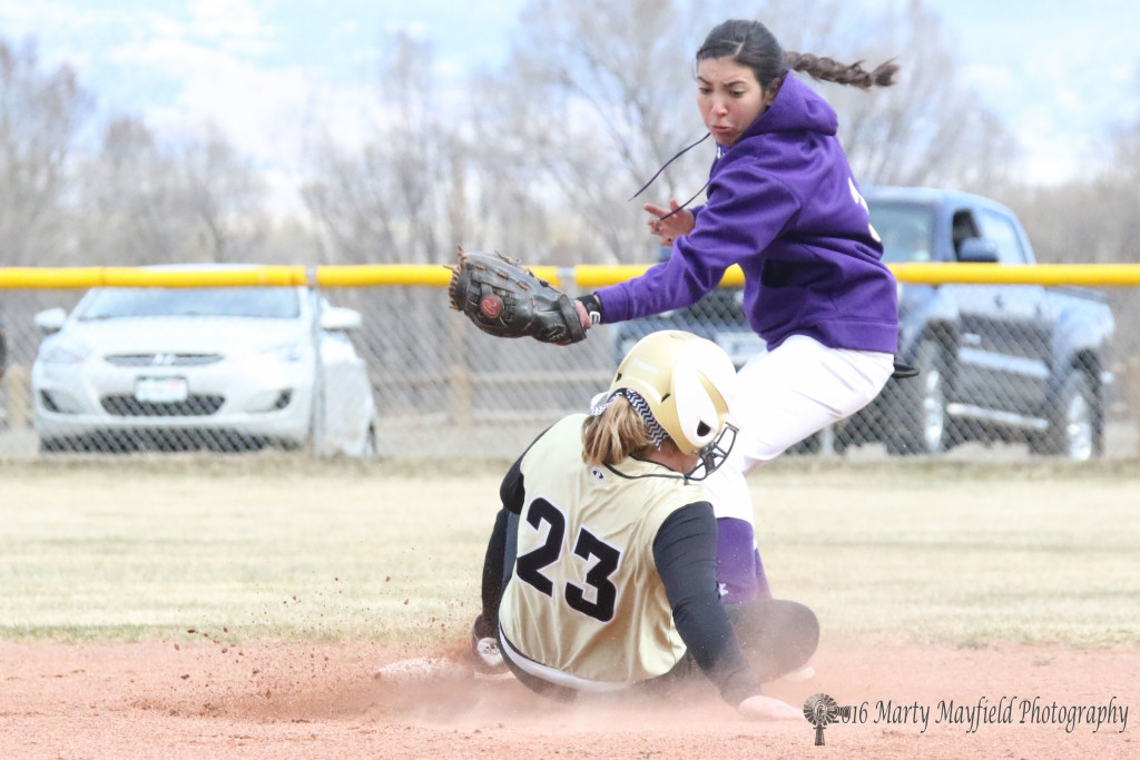 Another close play at second as Jadyn Walton slides in safe in the second inning of a three inning game.