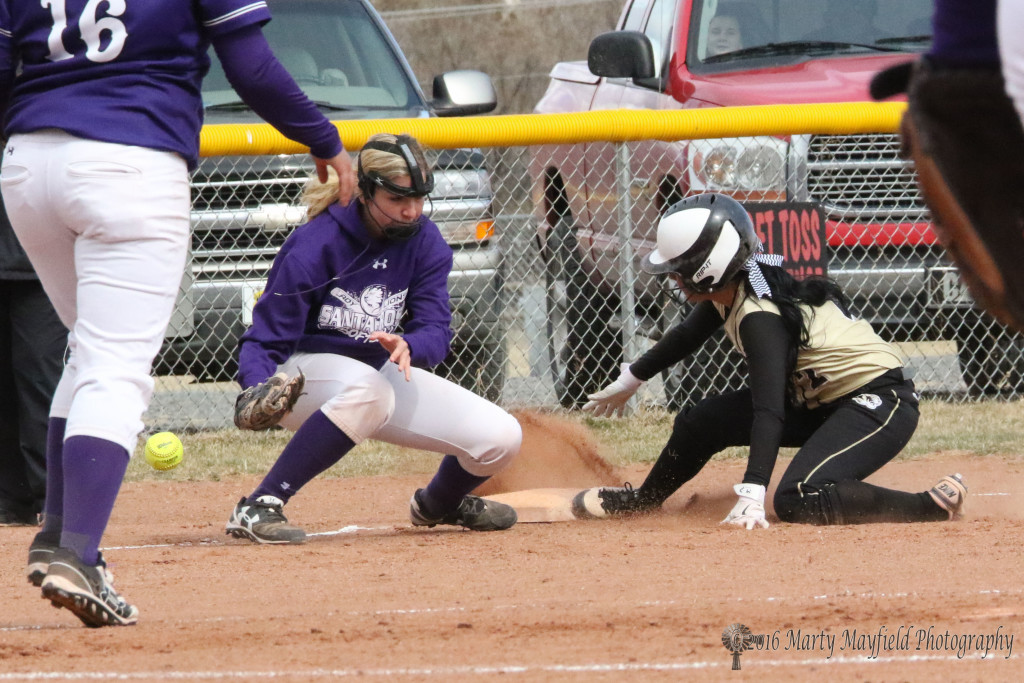 Natasha Ortega finds third base as the ball bounces free from third baseman Jazmine Silva