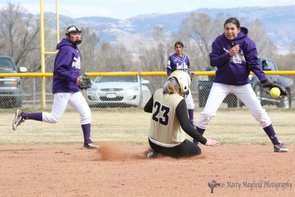 Again Jadyn Walton slides in safe at second as the throw from Santa Rosa's catcher Nicolette Gonzales goes wide.