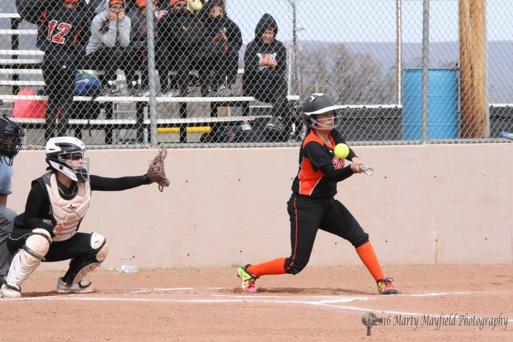 Its a Strike as the ball flies by a Taos batter in the first inning.