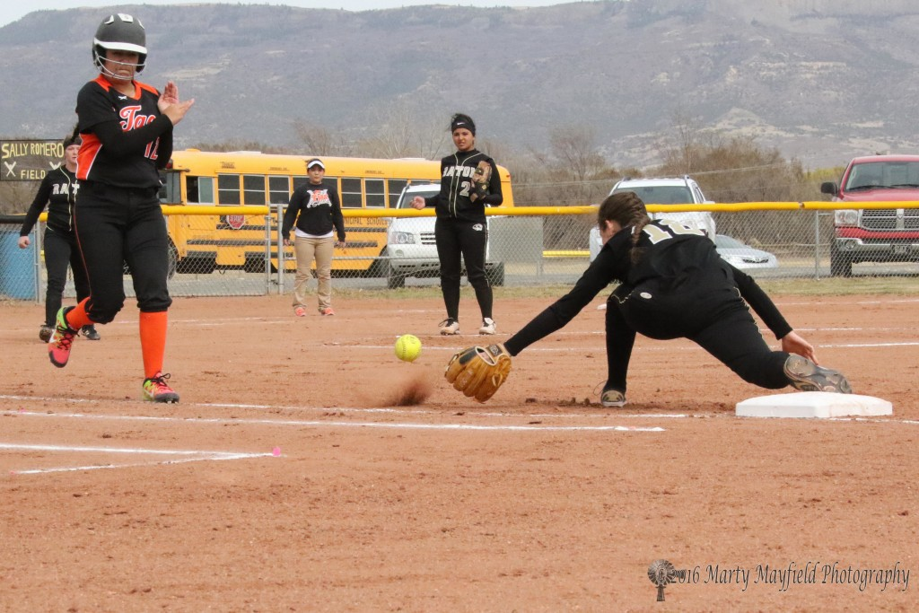 The ball goes wide as Halle Medina reaches out for it. The error allowed a Taos run later in the inning.