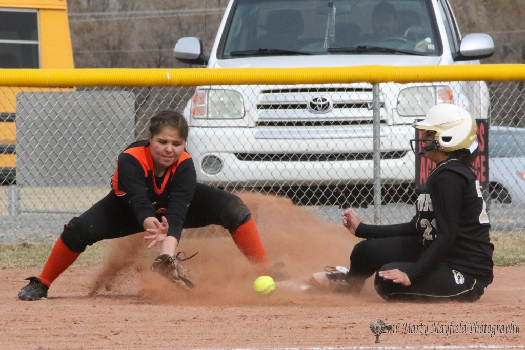 Natasha Archuleta slides safe into third as she beats the ball. She actually ended up with the ball in her lap on that play.