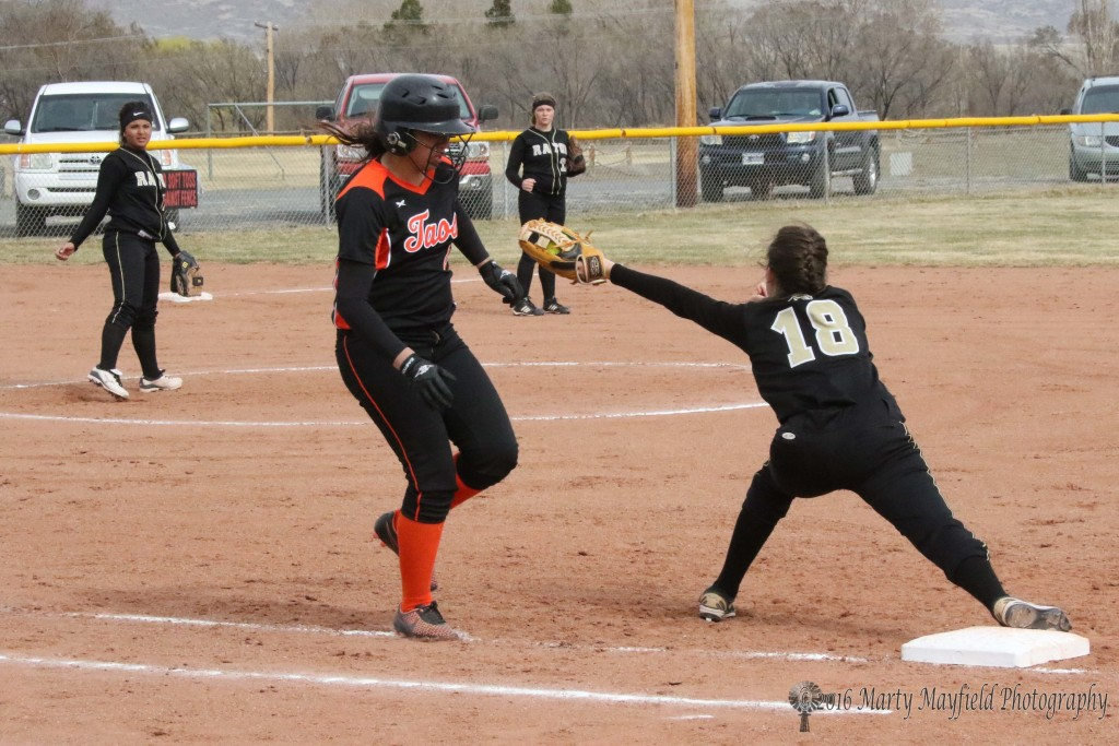 Halle Medina once again reaches out for the ball and makes the out at first.
