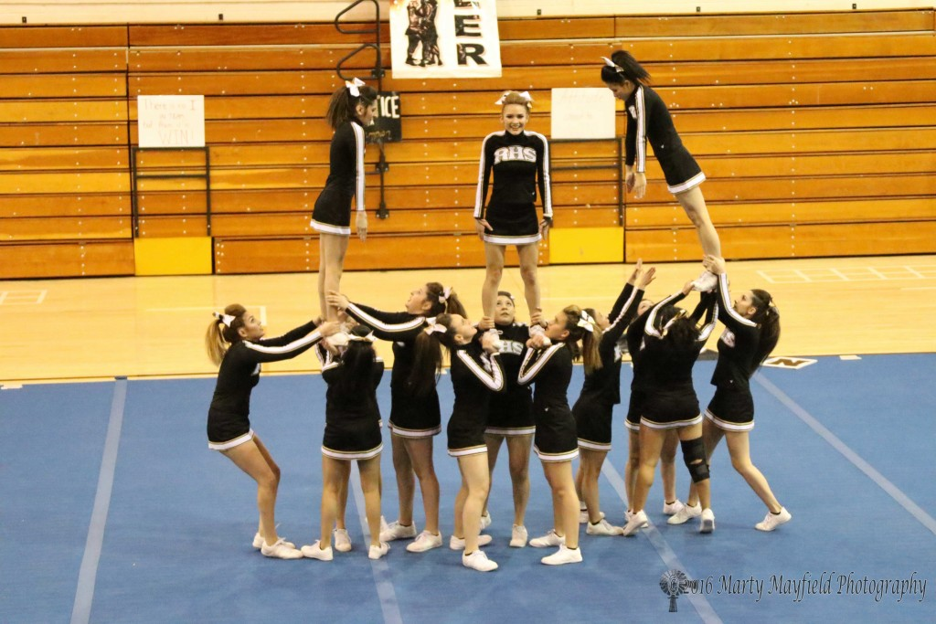 RHS Cheer during their state preview performance in tiger Gym on Tuesday before the State Spirit Competition