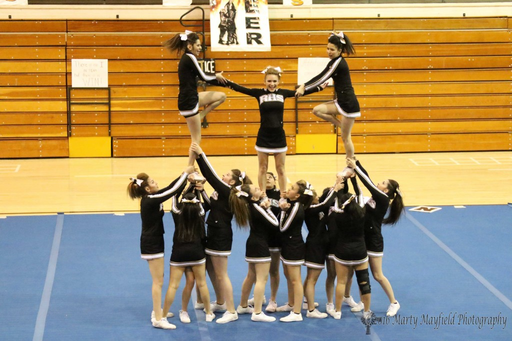 RHS Cheer in one of their stunts at the state preview performance on Tuesday