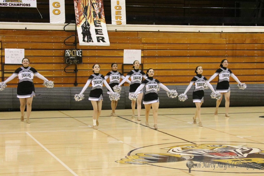 TigerCats Dance team take the floor as they showoff their state routine during the state preview performances at Tiger Gym on Tuesday