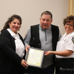 Supervisor Carol Baca and Dispatcher Valerie Monica accepted the Proclamation for National Tele-Communicators Week from Commissioner Ron Chavez.  Not pictured are dispatchers: Apryll Lopez, Amy Pilsner, Stevi Salazar and Christine Blocker