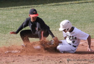 Ethan  Slides is called out as he slides into third base late in the Clayton double header