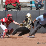 Lynsey Plant reaches for the tag and the out as Jadyn Walton slides home