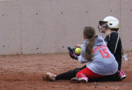 Its the final play of game two as Camryn Stoecker slides into home plate as pitcher Izabella Kuntz goes for the tag, Raton ended the game in three innings with this run 15-0