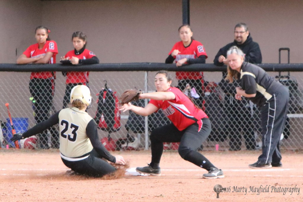 Jadyn Walton slides for third and makes it just ahead of the ball Saturday morning