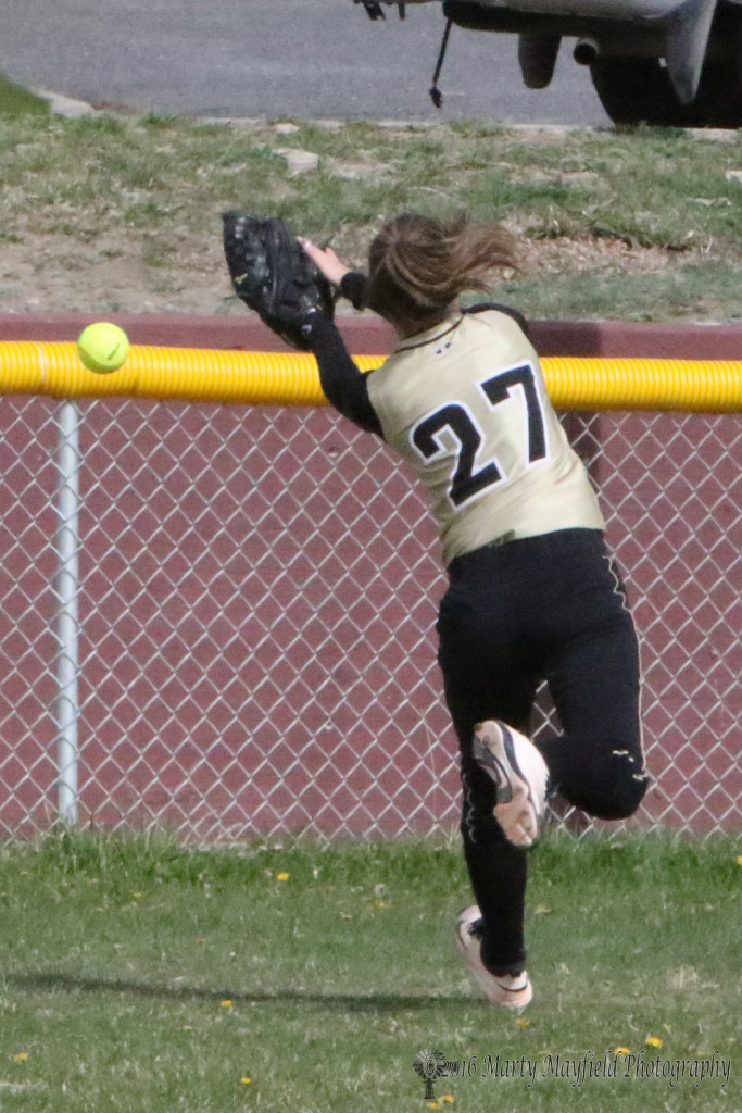 Camryn Mileta just misses the ball as the girls continued to have problems getting to the fly balls Saturday morning against Robertson