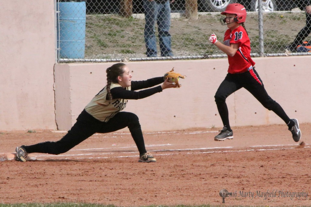 Its an out at first as the ball reaches Halle Medina well ahead of the Makayla Quintana