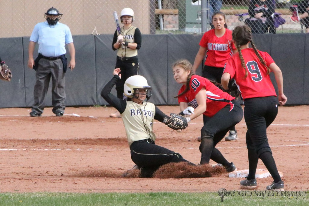 Natausha Ortega is tagged out by Ashlea Lujan as she slides for second base