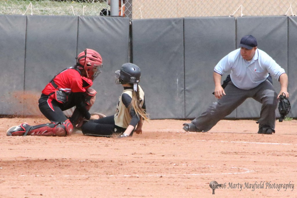 Is she out or safe as Mariah Encinias slides home in the second game of the double header with Robertson. The call was out as catcher jasmine Jaramillo tags her just in from of the plate.