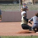 Sophia Madellini was called safe as she slides into second as Lazara Garcia  goes for the tag.