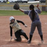 Sophia Madellini slides into third under the ball as it arrives late to third baseman Audriana Lalane.