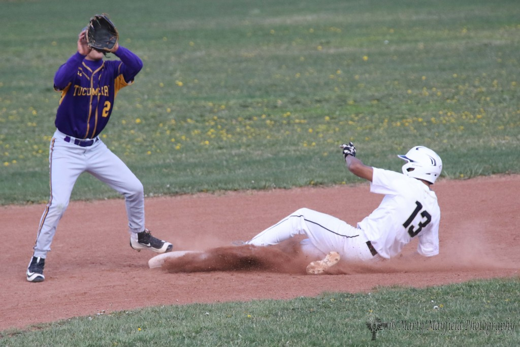 Jonathan Cabrieles slides into second well ahead of the ball as second baseman Joe Martinez waits for the ball to get there.