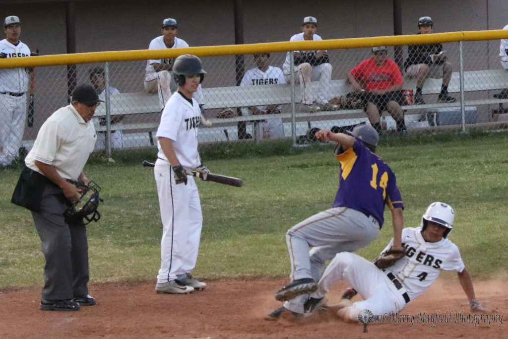 Ethan Martinez slides home as pitcher Zach Martinez makes the tag