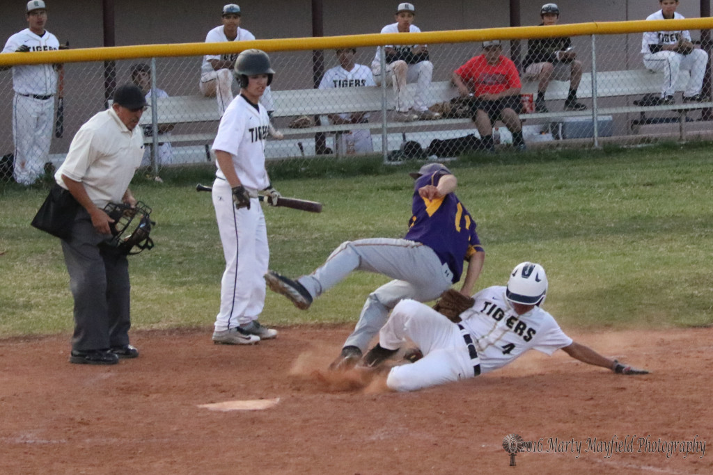 Ethan Martinez is tagged out by Rattler pitcher Zach Martinez as he goes to the ground.