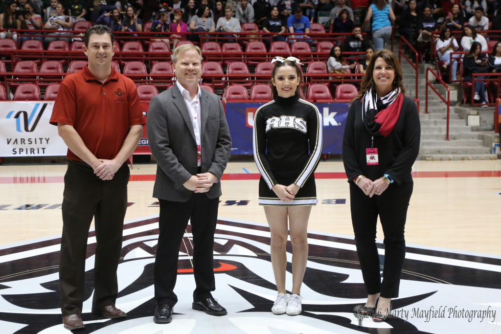 L to R NMAA Associate Director Dusty Young, Brian Denton, Alyssa Aragon and Karie Lee Chard Raton's Alyssa Aragon was recognized Saturday morning for winning the El Richard/Frances Walsh Scholarship. Aragon received the plaque at a ceremony during the state basketball championships where cheer and dance teams also compete in a competition.