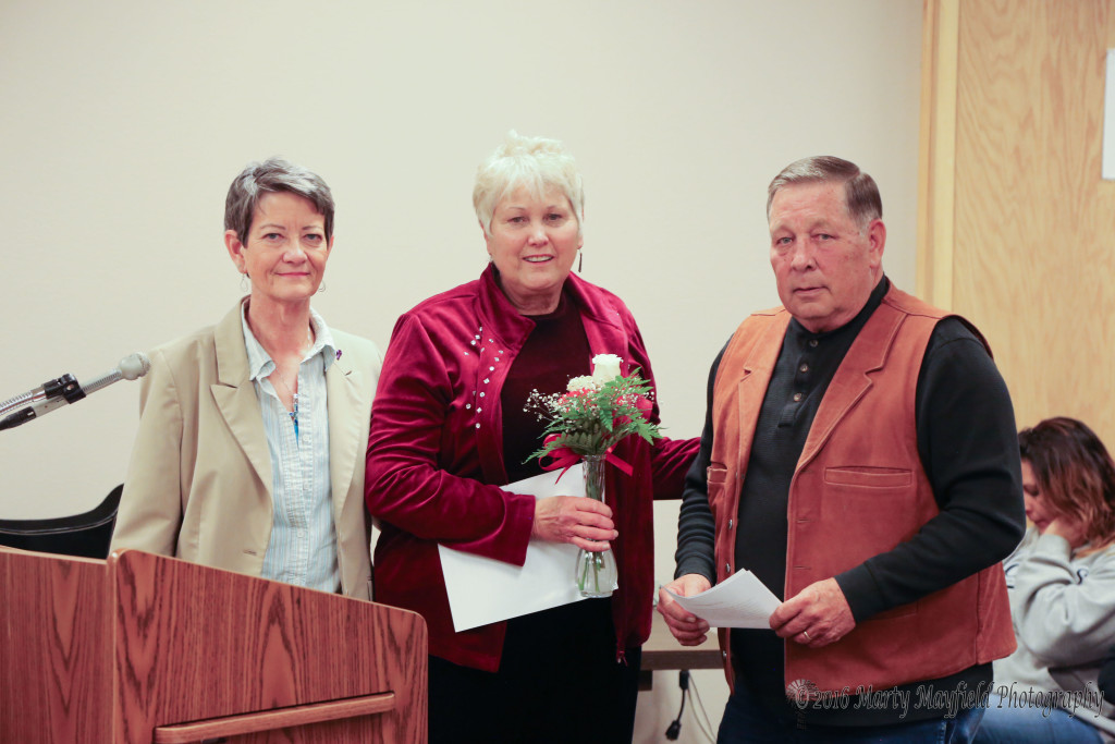 Nancy Poe was awarded the You Rock Award for her voluntarism during the winter storm event that stranded motorist in Raton in late March. Adrianne Coleman and Commissioner Ron Chavez present Poe the award at the Raton city commission meeting Tuesday evening.