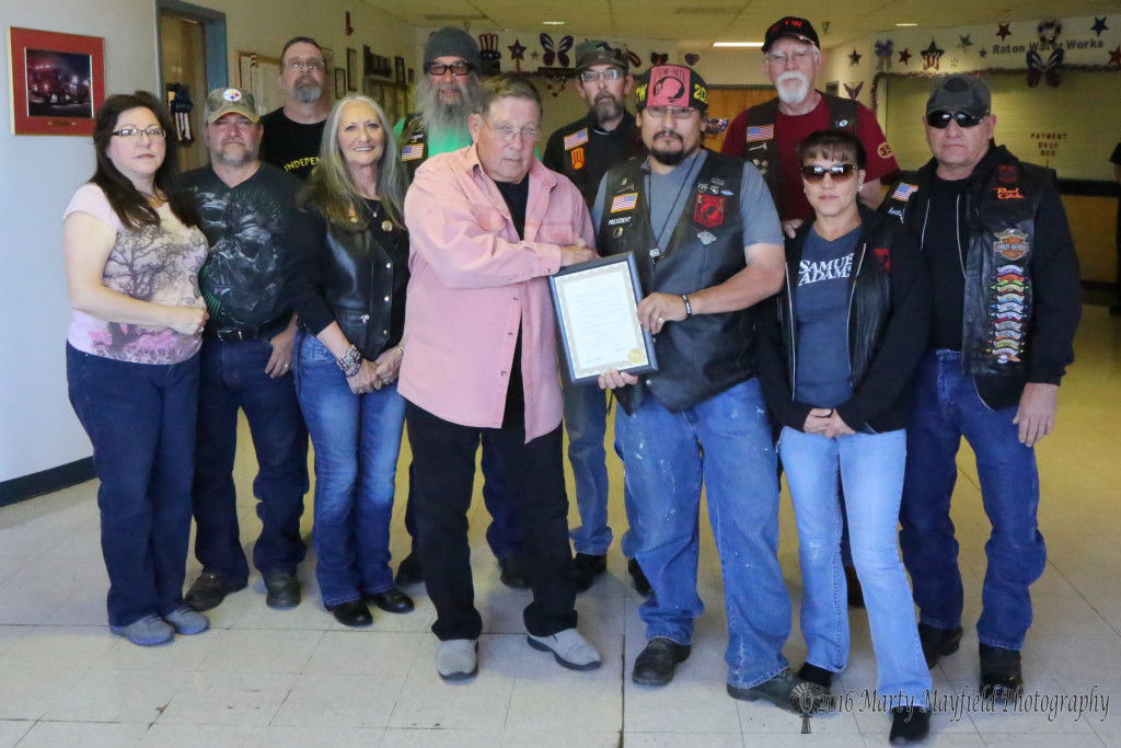Commissioner Ron Chavez presented the Independent Riders with a proclamation for their work with the Run for the Wall L to R Lorri Adam Zamora, Mark Baxter, Paula and Joe Cacciatore, Commissioner Ron Chavez, Fred Cochran, Tim Trujillo, Larry Osborn, Patricia and Everett Butch.