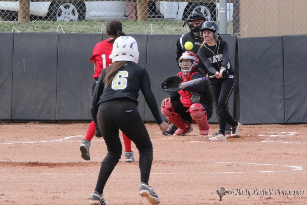 Mariah Encinias makes contact and sends another ball flying.